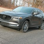 Mazda's 2021 CX-5 AWD compact crossover combines utility with sporty handling while boasting top safety scores